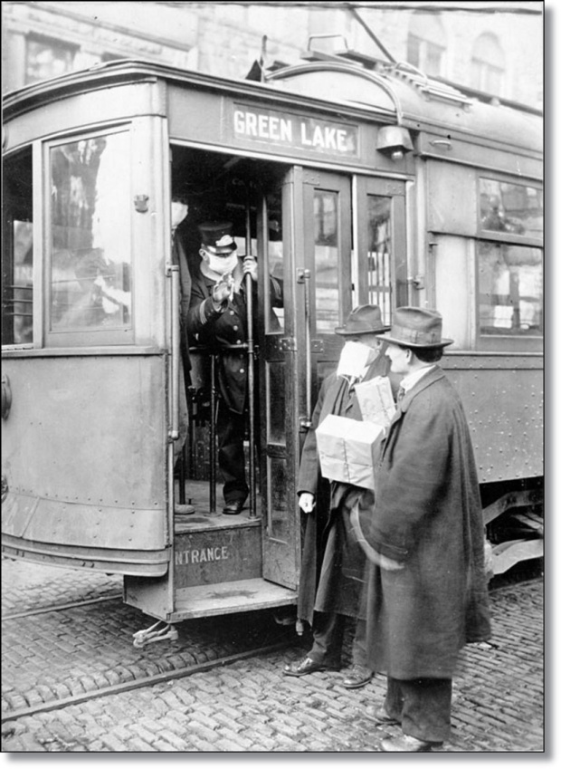 2078542-a_street_car_conductor_in_seattle_in_1918_refusing_to_allow_passengers_aboard_who_are_not_wearing_masks