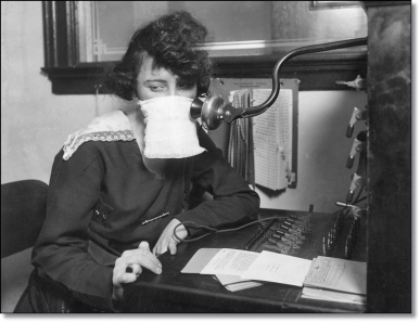 (Original Caption) Flu epidemic, 1918: Telephone operater with protective gauze.